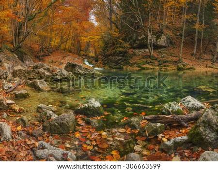 Lake in autumn canyon. Beautiful natural autumn landscape - stock photo