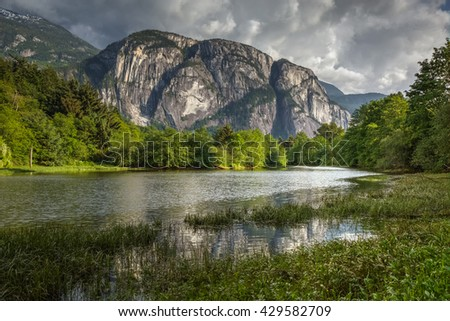 Lake in Squamish, BC, Canada. With Chief Mountain as it's background on a cloudy evening - stock photo