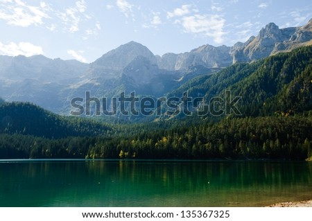 Lake in the Alpine mountains, Italy - stock photo