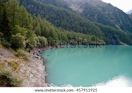 Lake in the Alps. Beautiful sunny day. - stock photo