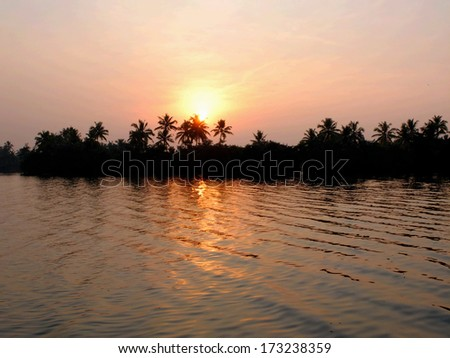 Lake in the backwaters of Kerala, India. - stock photo
