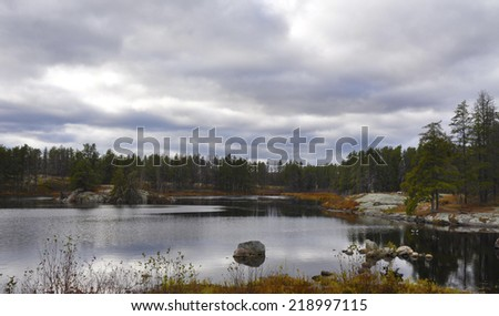 lake in the cabin country autumn scene - stock photo