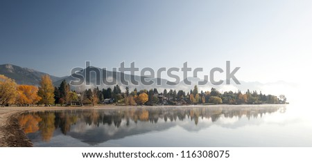 Lake in the fall with mountains
