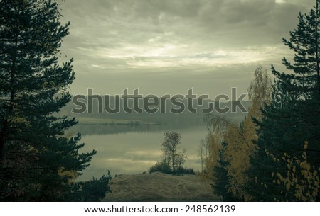 Lake in the forest and beautiful clouds. Landscape. Toned. - stock photo