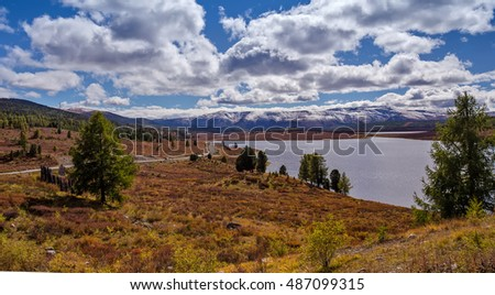 lake in the vicinity of the autumnmountain pass Ulaganskiy. Altai, Russia
