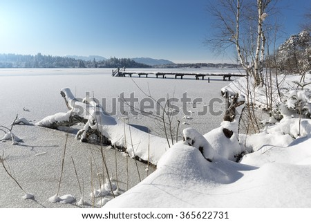 Lake Kirchsee in Bavaria, Germany, in winter - stock photo