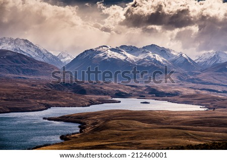 Lake landscape under heavy clouds - stock photo