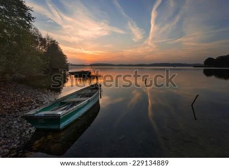 lake landscape with boat on shore - stock photo