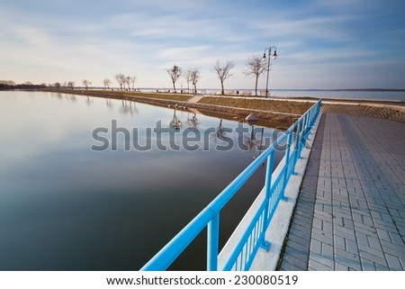 Lake landscape with pier - stock photo