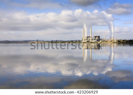 Lake Liddell coal fired power station, reflecting in Lake Liddell,  NSW, Australia.