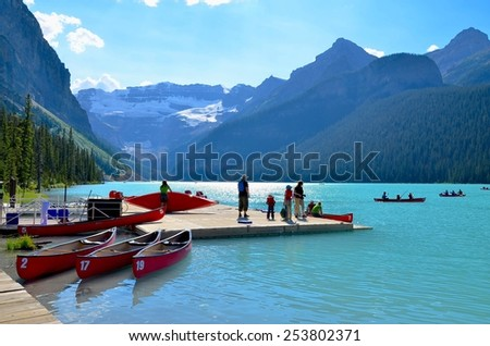 LAKE LOUISE, ALBERTA - AUGUST 1 - Lake Louise in Alberta, Canada on August 01, 2014. The beautiful Lake Louise is visited by millions of people every year. - stock photo