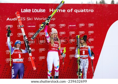 LAKE LOUISE ALBERTA CANADA , ITALY 6 December 2014.  The winning USA Team poising for photographers after the Ladies Super G event. The winner (Lindsey Vonn-in the middle).with her two USA team mates. - stock photo