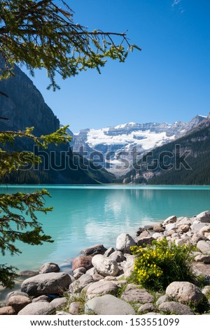 Lake Louise and Mount Victoria with its Glacier, Alberta, Canada. Vertical. Copy space. - stock photo