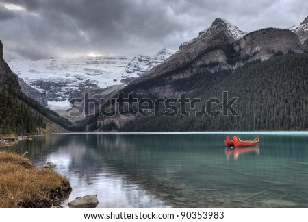 Lake Louise Glacier  canoe and emerald color - stock photo