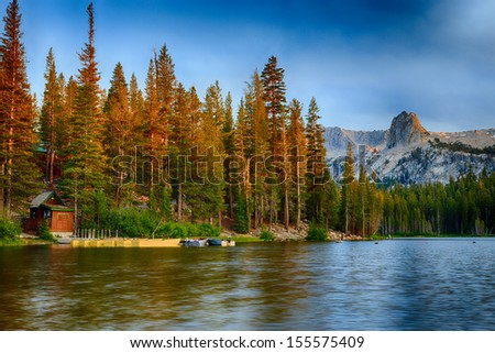Lake Mamie Boat House near Mammoth Lakes at sunrise in the California Eastern Sierra Mountains. - stock photo