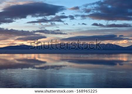 Lake Manasarovar (Mapam Yumco) at the sunrise, Western Tibet - stock photo