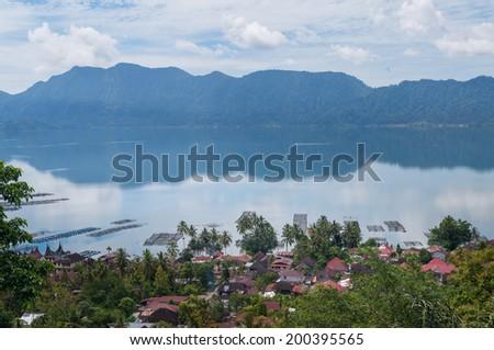 Lake Maninjau (Danau Maninjau) is a caldera lake in West Sumatra, Indonesia. - stock photo