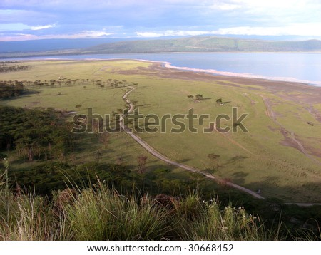 Lake Manyara landscape view from the top of a hill - stock photo
