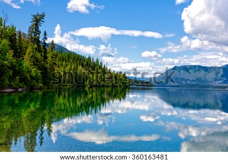 Lake McDonald located in Glacier National Park with water reflections