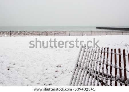 Lake Michigan beach covered with snow