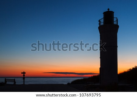 Lake Michigan Lighthouse at Sunset. Robert H. Manning Memorial Lighthouse in Empire, Michigan. - stock photo
