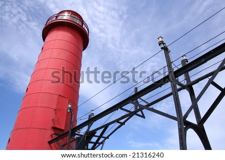 LAKE MICHIGAN LIGHTHOUSE One of the two lighthouses on the pier on Lake Michigan in Grand Haven, Michigan. - stock photo