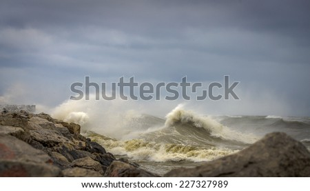 Lake Michigan shoreline with crashing waves - stock photo