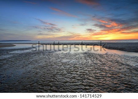 Lake Michigan sunset, mouth of the Otter Creek Sleeping Bear Dunes National Lakeshore - stock photo