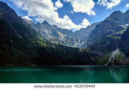 """Lake """"Morskie Oko"""" and rocky peaks in the High Tatras mountains in Poland - stock photo"""