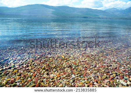 Lake of clear water. in Glacier National Park. - stock photo