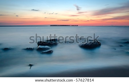 Lake on sunset. long exposure shot with blurred water - stock photo