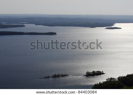 Lake Pielinen photographed in morning light from the Koli Mountain, Finland. - stock photo