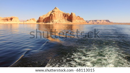 Lake Powell in Glen Canyon Recreation Area has lots  of recreational water opportunities, including houseboat rentals, water skiing, jet skiing, fishing, swimming, and exploring surrounding canyons - stock photo