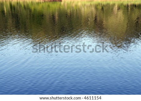 Lake reflection - stock photo