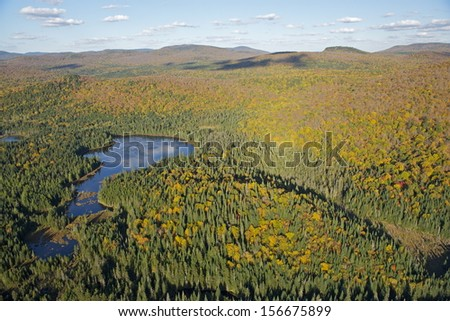 Lake reflections in the fall, Mont Tremblant National Park, Quebec, Canada - stock photo