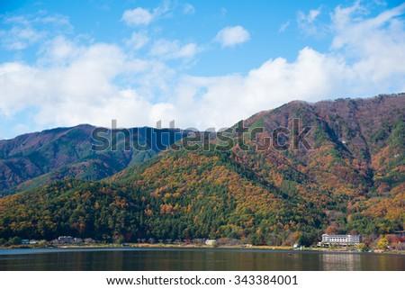 Lake reflections of fall foliage - stock photo