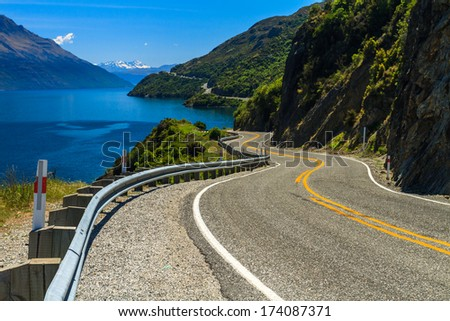 Lake Road and Mountains, Queenstown, South Island, New Zealand - stock photo