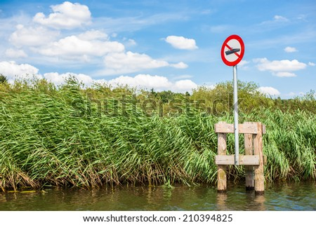 Lake scenery with a red no boating sign