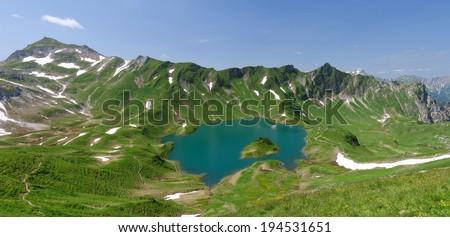 Lake Schrecksee, an alpine lake in the Allgaeu alps near Hinterstein, Bavaria, Germany - stock photo