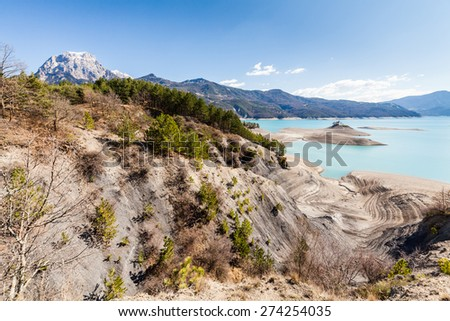 Lake Serre-Poncon and a small church on a island, Hautes-Alpes, France - stock photo