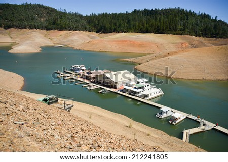 Lake Shasta, CA, August 17, 2014 -- California's drought exposes the 180-200-foot drop in water levels at the Silverthorn Resort. The reservoir is receding at an average of 4.9 inches per day.