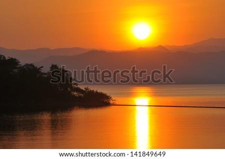 Lake sunset and sky - stock photo
