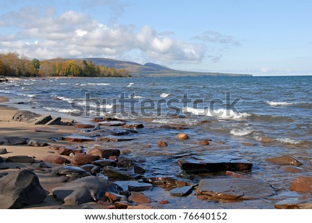 lake superior shore looking towards porcupine wilderness state park - stock photo