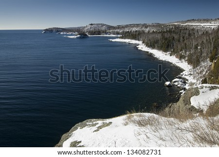 Lake Superior shore with snow at Split rock lighthouse State Park, Minnesota - stock photo