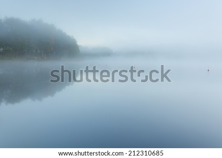 Lake Swieszyno in north Poland.Kashubia province. / Tranquil and misty lake  - stock photo