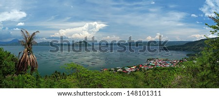 Lake Taal, the caldera of a super volcano and the world's smallest volcano, Taal, in its center. Taal is one of the ten most active volcanoes in the world. - stock photo