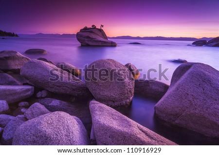 Lake Tahoe in purple sunset - stock photo
