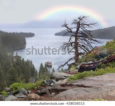lake Tahoe. Landscape with stones, dead tree,forest and rainbow. - stock photo