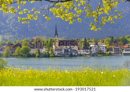lake Tegernsee in Bavaria with church of city Rottach-Egern - stock photo
