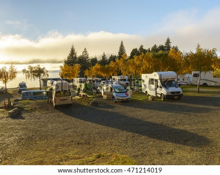 LAKE TEKAPO, NEW ZEALAND -MAY 6, 2016: Group of Motorhomes and Campervans parked on the lakeside of Lake Tekapo. This kind of vehicles is a popular way for most of tourists to exploring New Zealand.